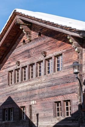 """The inscription reads, """"Jesus Marie Joseph protèges cette maison bâtie par la louable communauté de Saint Luc sous la présidence des respectables Pierre Martin et Louis Zufferey l'année de l'incendie 1845"""""""